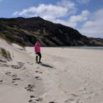 An Ireland by Bike client at Maghera strand while she was on our Backroads and Beyond cycling and walking vacation
