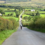 Solo cyclist cycling towards Moville on the Causeway Coast cycling tour with Ireland by Bike