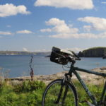 Bicycle overlooking Rathlin Island on Causeway Coast cycling vacation with Ireland by Bike