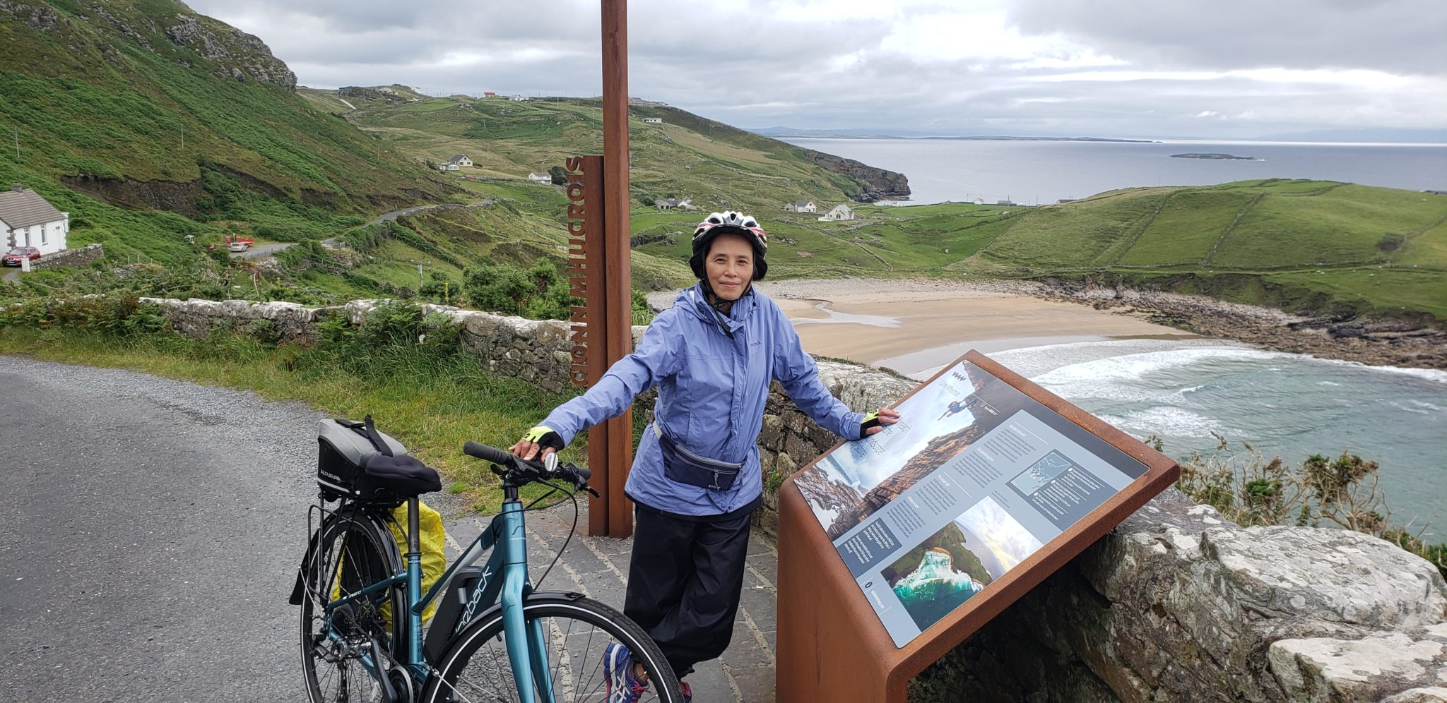 Woman with Bicycle at Muckross Head Viewing Point