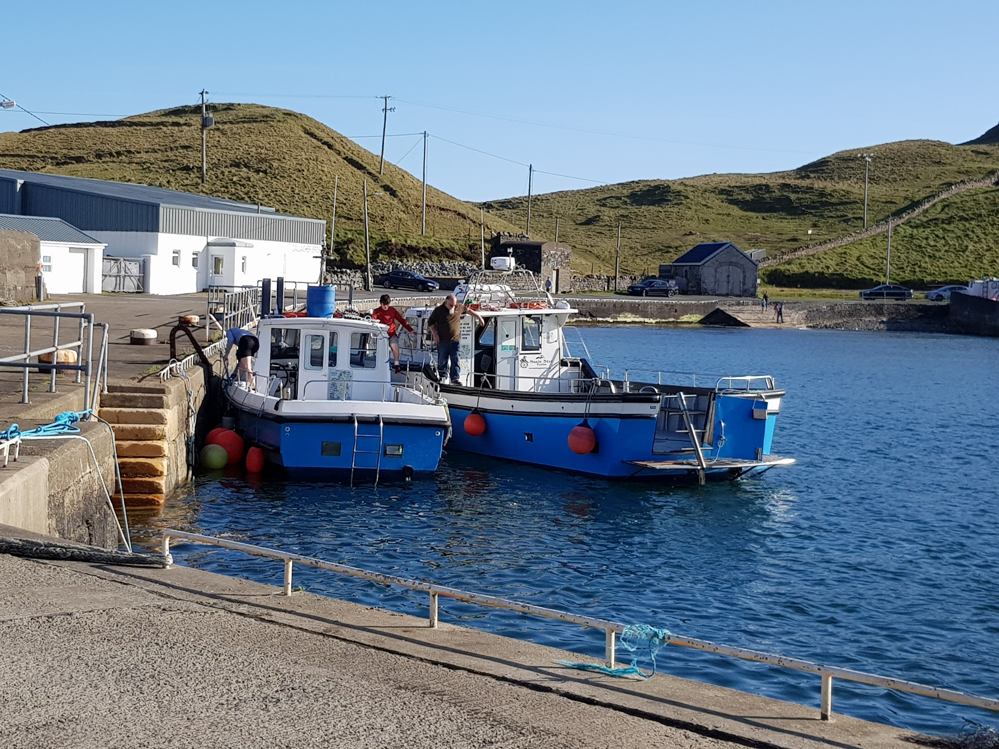 Boat at Teelin Harbour ready to leave en route to see the Bunglas cliffs