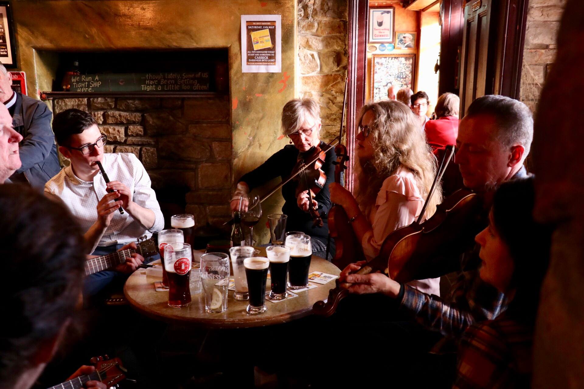 Musicians playing traditional Irish Music in a pub
