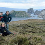 Group Hiking along the coast to Port, Donegal, Ireland