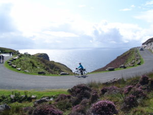 Staff member Cormac cycling at Sliabh Liag (Slieve League)
